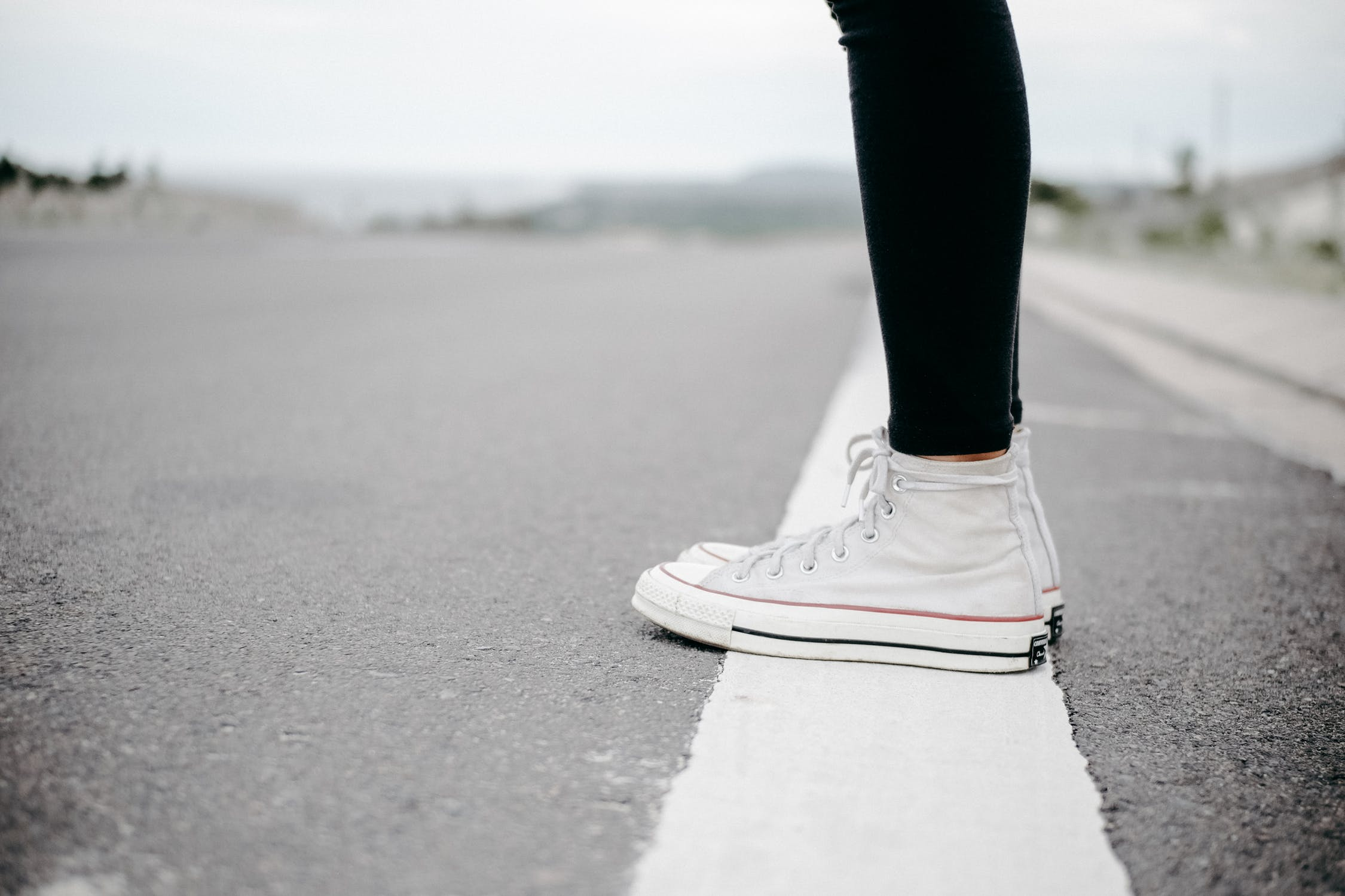 standing on white line
